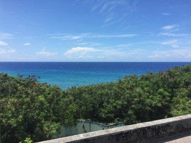 View from the roof: the pool, and beyond it - the deep blue Caribbean Sea