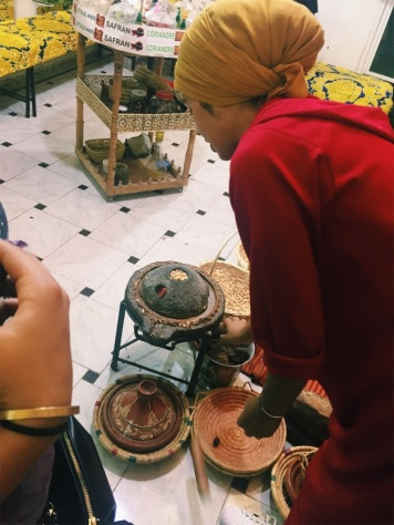showing us how to make Argan oil